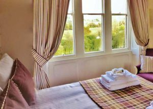 One of our beautiful en-suite bedrooms. Spectacular views can be found at every window.